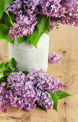 beautiful lilac on dark wooden surface