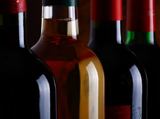 Red and white wine bottles in a row