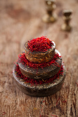 saffron spice in antique vintage iron bowls weights stacked on w