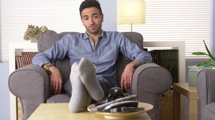 Attractive Latino sitting in his living room