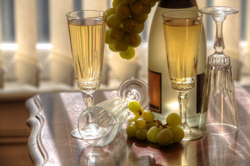 Champagne, glasses and grapes.