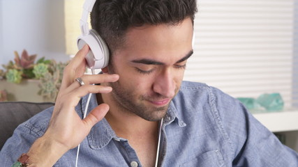 Handsome Mexican guy listening to music