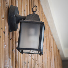 Old style Street lamp on bamboo wall