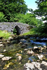 Stream and Old Stone Arched Bridge
