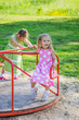 two girls swinging on playground