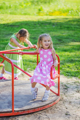 two girls swinging on playground