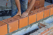 Bulder worker laying clay block 2