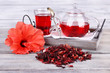 Leinwandbild Motiv Hibiscus tea in glass teapot and flower