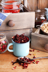 Dried hibiscus tea in color mug, brown sugar  in box