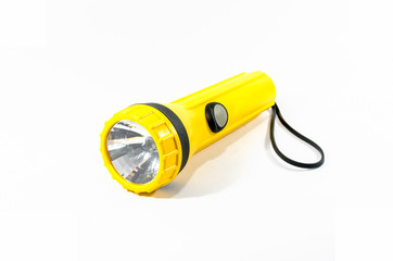 yellow plastic torch flashlight isolated on white