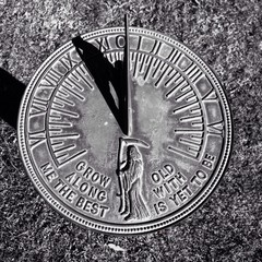 sun dial with symbol of death