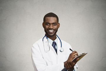 Male health care professional, doctor taking patient notes