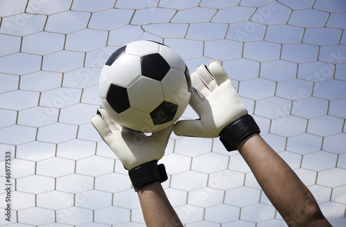 canvas print picture goalkeeper's hands reaching foot ball