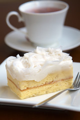close up coconut cake in white dish