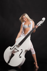 Young Woman Playing On a Double Bass