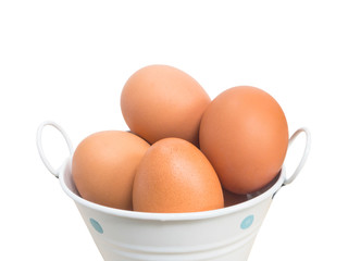 White bucket with brown eggs