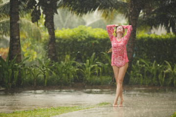 Portrait of beautiful woman under the tropical rain