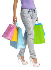 Colorful Shopping Bags and Sexy Female Legs isolated