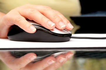Woman hand using computer mouse