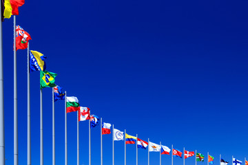 Flags against blue sky, copyspace