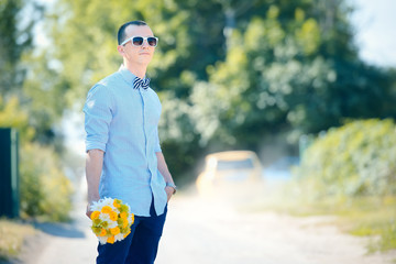 Wedding groom with flowers bouquet