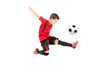 Junior football player kicking a ball - 66982528