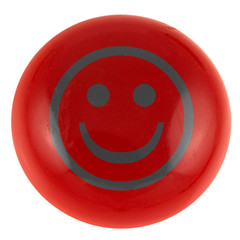 smiley souriant sur bouton rouge