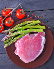 raw meat and asparagus