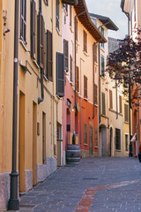 colorful houses in an alley of Desenzano, Garda lake