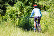 Young woman with mountain bike outdoors. - 66984721