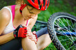 Young woman fell off mountain bike. - 66984781