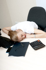 Tired young  businesswoman  sleeping at work.