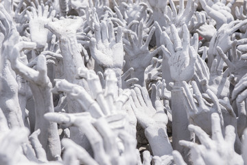 Hands from Hell in the White Temple, Chiang Rai, Thailand.