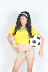 Portrait Beautiful woman hold ball with wearing Brazil football