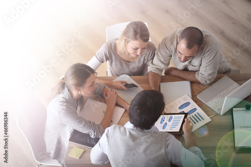 canvas print picture Upper view of business people around table