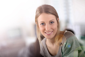 Portrait of pretty young woman in office
