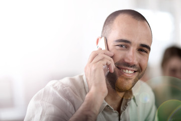 Cheerful salesman talking on the phone