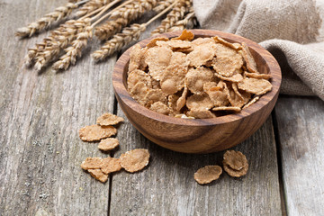 wholegrain flakes in a wooden bowl