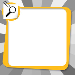 yellow text box with paper clip and magnifier