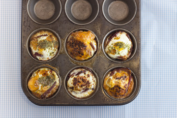 Freshly baked paleo muffins in a pan, overhead view