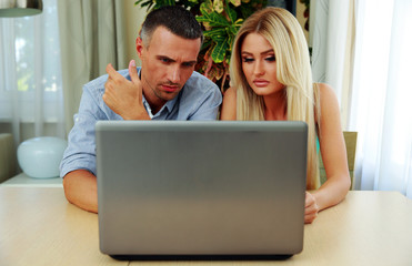 Young couple using laptop together