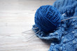 Ball of yarn and knitting on a wooden table - 66990562