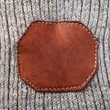 knitted fabric texture with leather emblem