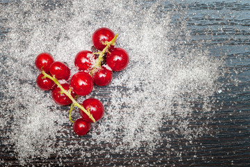 Red currant berries sprinkled with sugar