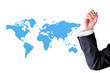 Businessman hand with blank world map