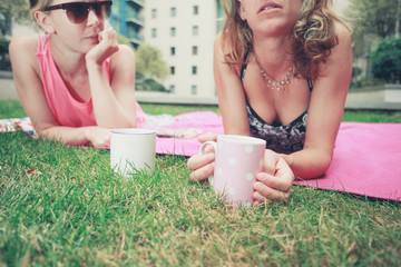 Two young women having tea outside