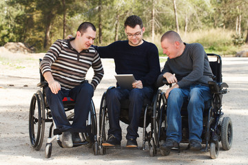 Disabled friends with digital Notebook