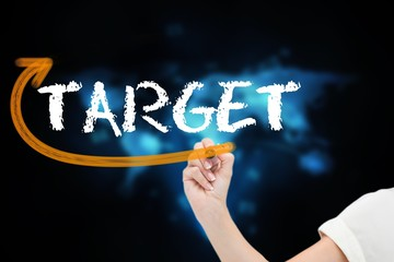 Businesswoman writing the word target