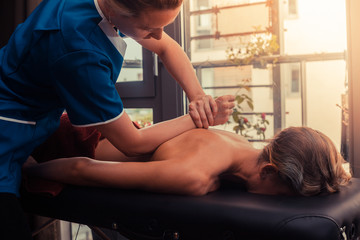 Massage therapist treating a client