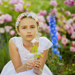 Summer garden - beautiful girl  in the flower garden